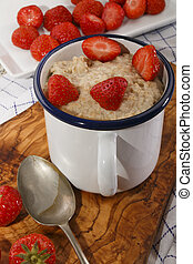scottish breakfast with strawberries in an enamel jug