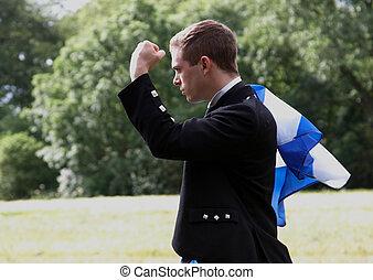 Scottish man in a field