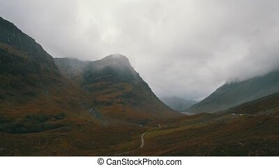Scottish mountains in highland - mist and clouds, wide angle