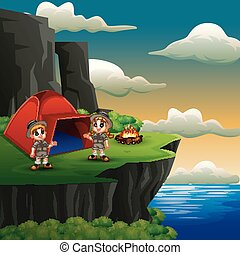 Scout boy and girl are camping on the cliff