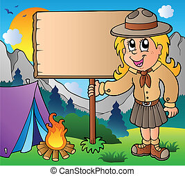 Scout girl holding board outdoor