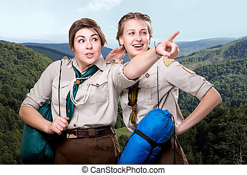 Scout tour - Two young scout girls with sleeping bags...