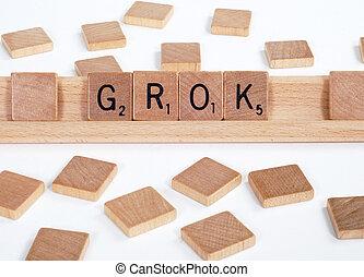 Scrabble tiles spell out 'Grok'