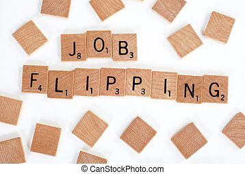 Scrabble tiles spell out 'Job Flipping'