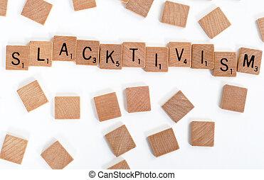 Scrabble tiles spell out 'Slacktivism'