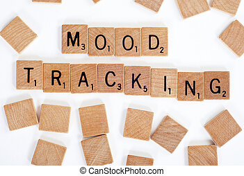 Scrabble tiles spelling out 'Mood Tracking'