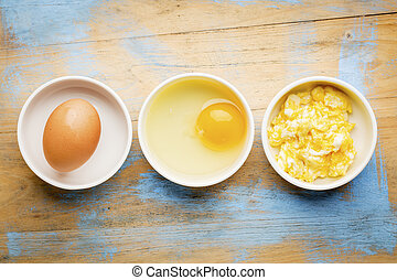 scrambled egg abstract - white bowls with eggs against ...