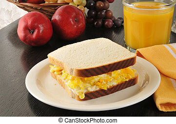 Scrambled egg sandwich - A scrambled egg sandwich with fruit...