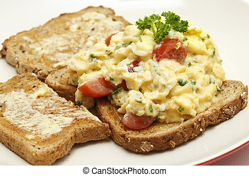 Scrambled egg with parsley and tomato