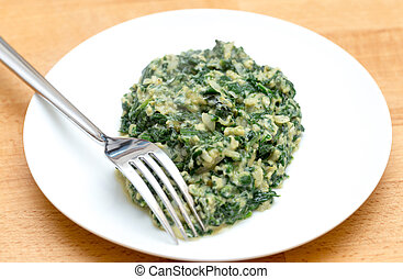 Scrambled egg with spinach and fork