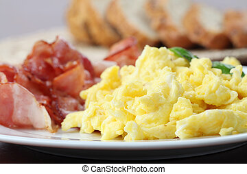 Scrambled eggs and bacon - Close-up of scrambled eggs and ...