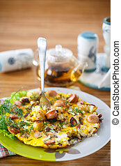 scrambled eggs and sausages cauliflower with dill on a...