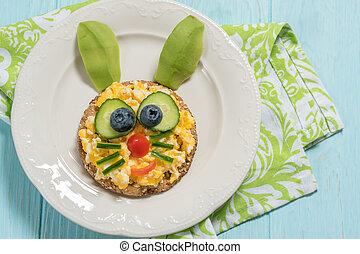 Scrambled eggs funny bunny for kid breakfast