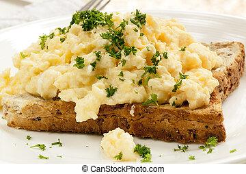 Scrambled Eggs on Toast - Scrambled eggs on toast, garnished...