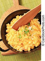 Scrambled eggs ready in a pan- closeup