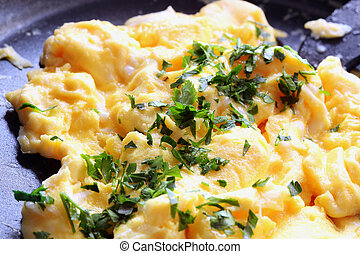 Scrambled Eggs - Scrambled eggs cooking in a frypan,...