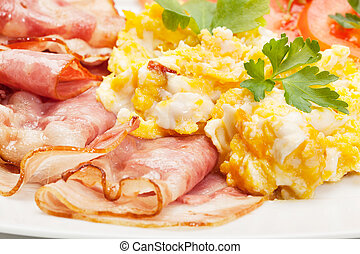 Scrambled eggs with bacon. Selective focus.