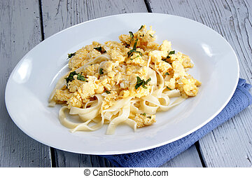 Scrambled eggs with home made noodles and chopped mint