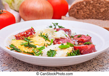 Scrambled eggs with sausage and vegetables