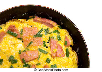 scrambled eggs with sausage in a frying pan on a white background