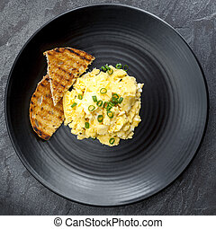 Scrambled Eggs with Toast on Black Plate