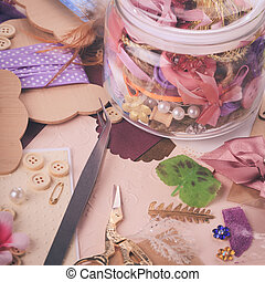Scrap details - Scrapbooking craft materials in a glass ...
