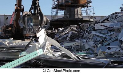 Scrap metal aluminum - Metal picked up by mechanical grabber...