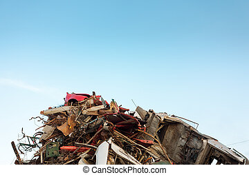 scrap metal pile with clear blue sky. copy space available