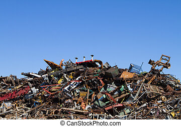Scrap metal waste is stored in a recycling yard waiting to be melted down to manufacture new products.