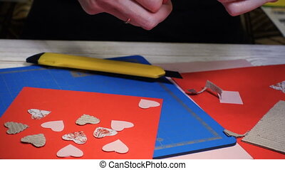 scrap Valentine greeting card - hands of girl making scrap...