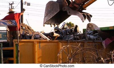 Crane moves scrap metal at a scrap yard in Los Angeles