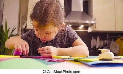 Little girl doing a postcard - Scrapbooking. Little girl...