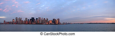 Scrape sky building shore line at the sunset from a boat - New York - Large Panorama.