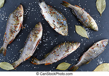 river fish crucian and perch in spices
