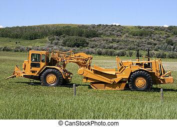 Heavy duty scraper - earth moving machine in Canada. Wheel tractor-scraper.