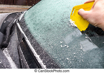 Scraping ice from the car windscreen