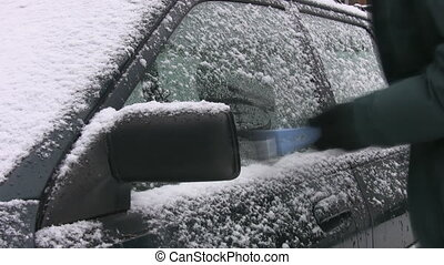 Scraping ice off car. Timelapse.
