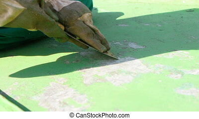 Scraping off Green Layer of Protective Paint - Detailed look...