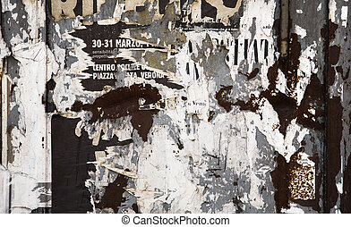Scraps of paper on a wall. Grunge background.