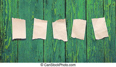 Scraps placed on the green wooden background