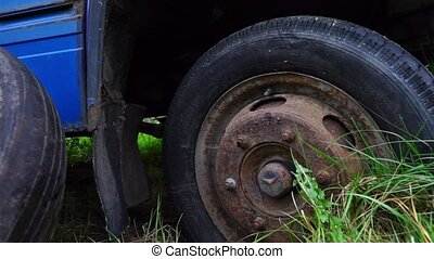 Scrapyard with old cars and cars parts - Close up view at...