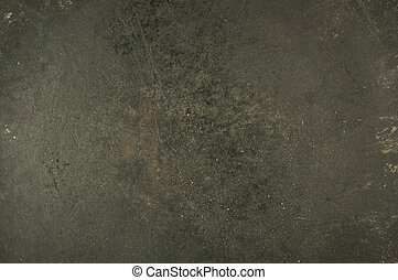 scratched bottom of an old iron pot, brutal metal background