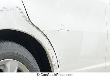 Scratched car - Car paint scratched at the door and the ...
