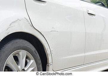 Scratched car - Car paint scratched at the door and the...
