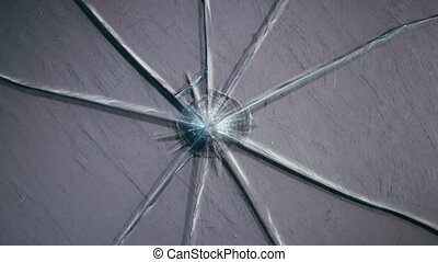 Scratched glass broken into pieces. Close up - Scratched...