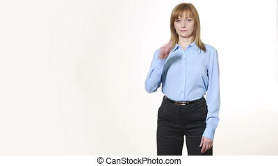 scratching his nose. lies gesture. girl in pants and blous. Isolated on white background. body language. women gestures. nonverbal cues