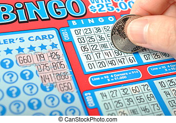 Scratching lottery ticket called bingo.