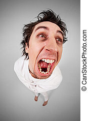 Scream - Fish eye shot of screaming insane man in...