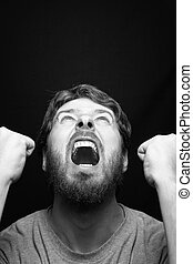 Scream of angry rebel man over black