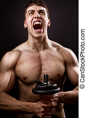 Scream of powerful muscular bodybuilder